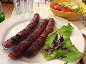 country sausages, cucumber and tomato salad